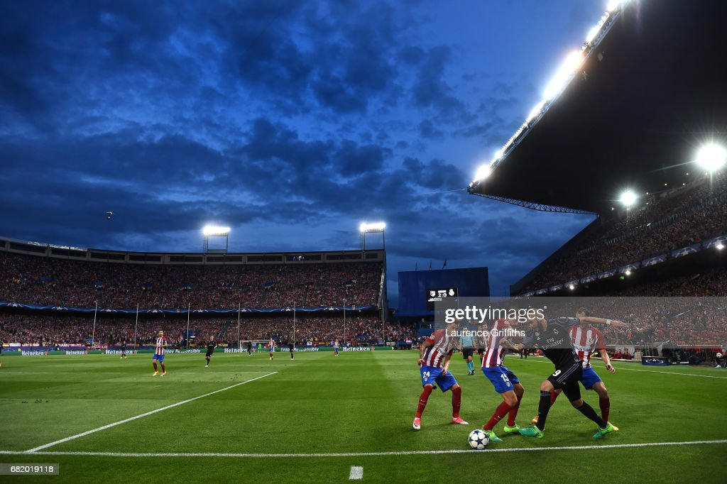 A general view as Karim Benzema of Real Madrid takes on Stefan Savic of Atletico Madrid during the UEFA Champions League Semi Final second leg match between Club Atletico de Madrid and Real Madrid CF at Vicente Calderon Stadium on May 10, 2017 in Madrid, Spain.
