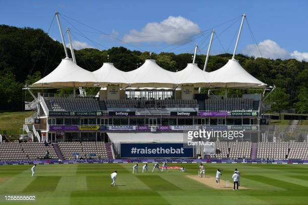 General view as Kemar Roach of the West Indies bowls to Dom Sibley of England during day four of the 1st #RaiseTheBat Test match at The Ageas Bowl on...