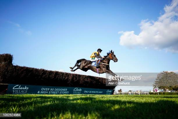 A general view as Kielan Woods riding Wisecracker clears a fence at Wincanton Racecourse on October 19 2018 in Wincanton England