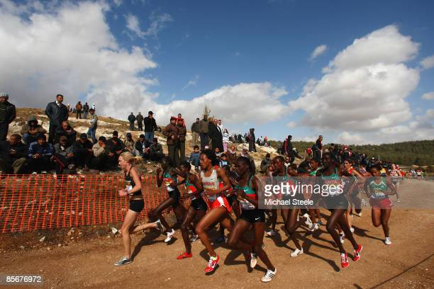 General view as Kimberley Smith of New Zealand leads the pack during the women's senior race at the 37th IAAF World Cross Country Championships at...