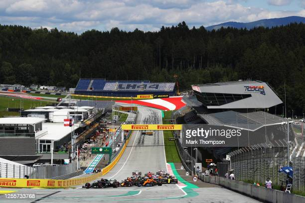 General view as Lewis Hamilton of Great Britain driving the Mercedes AMG Petronas F1 Team Mercedes W11 leads the field into the first corner during...