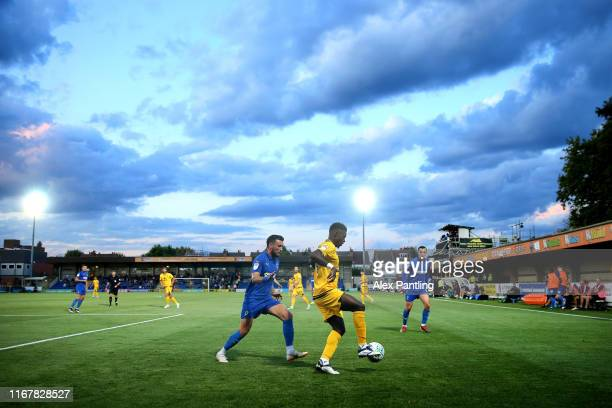 A general view as Luke O'Neill of AFC Wimbledon tackles Kieran Agard of MK Dons during the Carabao Cup First Round match between AFC Wimbledon and MK...