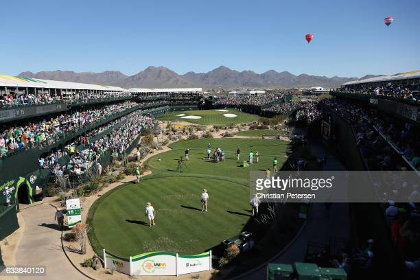 General view as Marc Leishman of Australia plays a tee shot on the 16th hole during the third round of the Waste Management Phoenix Open at TPC...