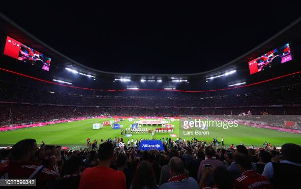 General view as mascots, players and officials line up prior to the Bundesliga match between FC Bayern Muenchen and TSG 1899 Hoffenheim at Allianz...