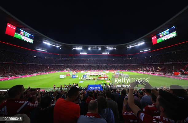 A general view as mascots players and officials line up prior to the Bundesliga match between FC Bayern Muenchen and TSG 1899 Hoffenheim at Allianz...