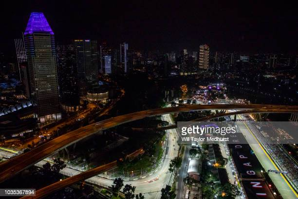 A general view as Max Verstappen of the Netherlands driving the Aston Martin Red Bull Racing RB14 TAG Heuer leads Sebastian Vettel of Germany driving...