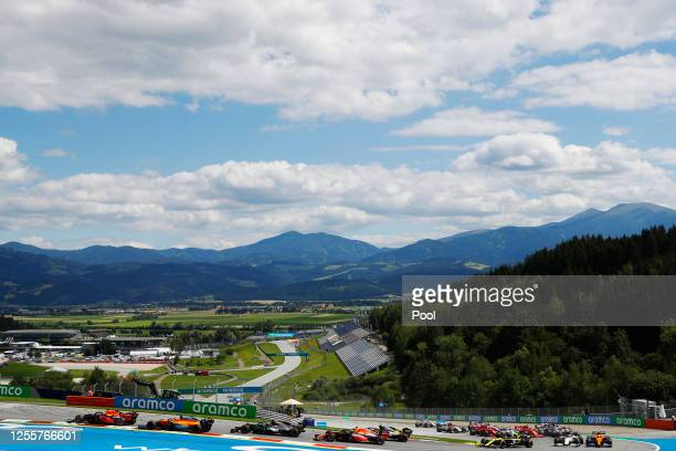 A general view as Max Verstappen of the Netherlands driving the Aston Martin Red Bull Racing RB16 leads a line of cars during the Formula One Grand...