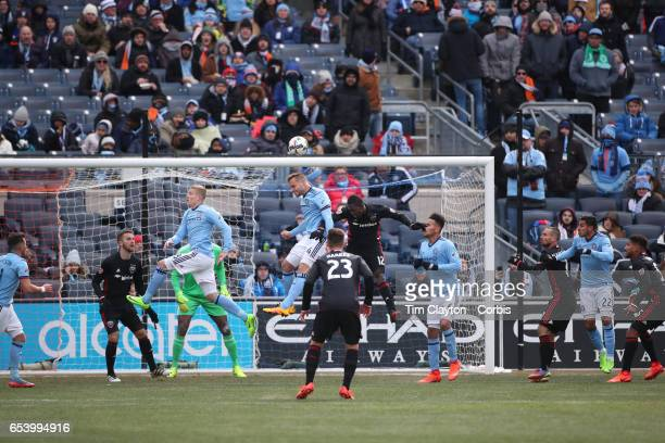 A general view as Maxime Chanot of New York City FC heads clear while challenged by Patrick Nyarko of DC United during the NYCFC Vs DC United regular...