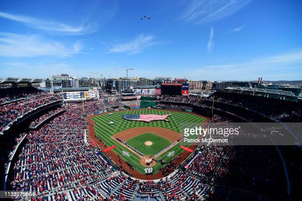 A general view as members of the New York Mets and Washington Nationals line the baselines as they listen to the playing of the national anthem on...