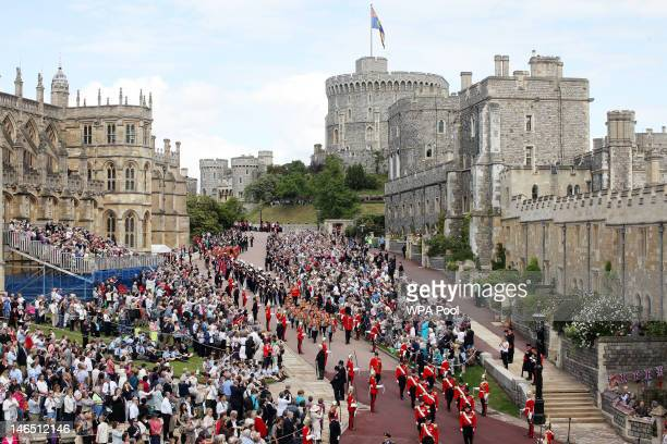 General view as members of the Royal family make their way to the annual Order of the Garter Service at St George's Chapel Windsor Castle on June 18...