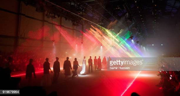 A general view as models walk the runway at the Burberry show during London Fashion Week February 2018 at Dimco Buildings on February 17 2018 in...
