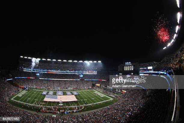 A general view as New England Patriots Super Bowl Championship banners and an American flag are displayed on the field during the national anthem...