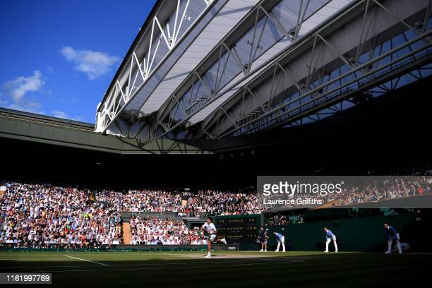 General view as Novak Djokovic of Serbia serves in his Men's Singles final against Roger Federer of Switzerland during Day thirteen of The...