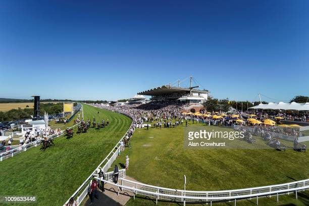 A general view as Paul Hanagan riding More Than This ease down after winning The Telegraph Nursery Handicap Stakes at Goodwood Racecourse on August 2...