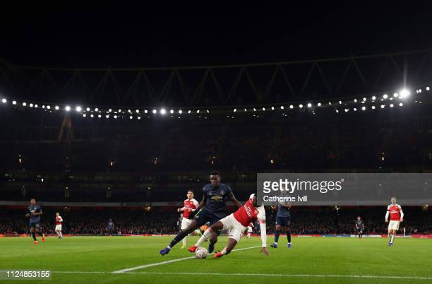 General view as Paul Pogba of Manchester United competes with Ainsley MaitlandNiles of Arsenal during the FA Cup Fourth Round match between Arsenal...