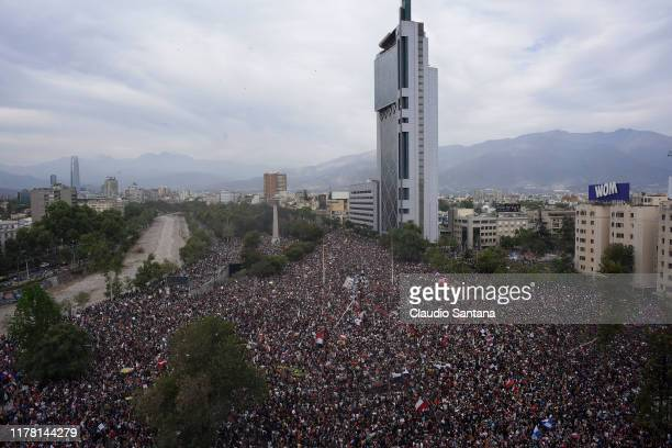 General view as people gather in a massive protest at Plaza Baquedano during the eighth day of protests against President Sebastian Piñera's...