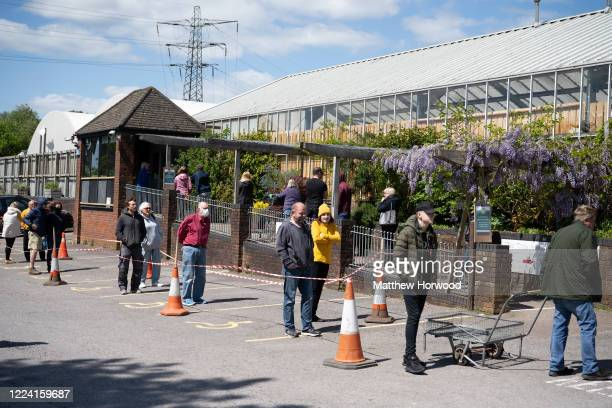 A general view as people queue at Caerphilly Garden Centre on May 11 2020 in Cardiff United Kingdom Wales' First Minister Mark Drakeford announced on...