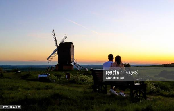General view as people watch the sunset at Brill Windmill on May 19 2020 in Brill England The British government has started easing the lockdown it...