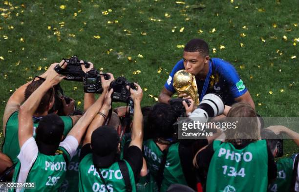 General view as photographers take pictures of Kylian Mbappe of France kissing the trophy after the 2018 FIFA World Cup Russia Final between France...