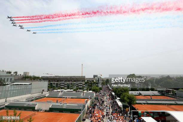 A general view as planes fly above court Philippe Chatrier leaving the colours of the French flag prior to the mens singles final between Rafael...