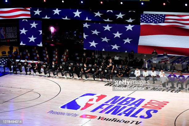 General view as players and coaches stand and kneel during the national anthem before Game Three of the 2020 NBA Finals between the Miami Heat and...