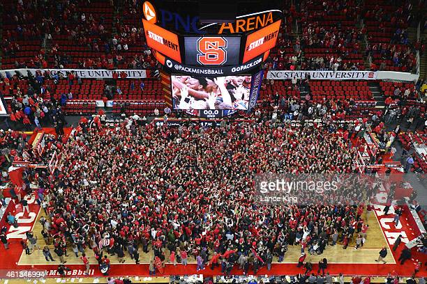 A general view as players and fans of the North Carolina State Wolfpack celebrate following their win against the Duke Blue Devils at PNC Arena on...