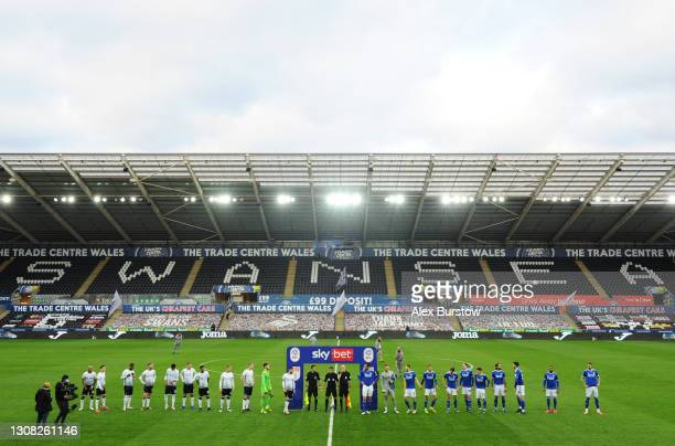General view as players and match officials line up prior to the Sky Bet Championship match between Swansea City and Cardiff City at Liberty Stadium...