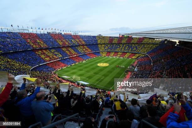 A general view as players and officials line up prior to the La Liga match between Barcelona and Real Madrid at Camp Nou on May 6 2018 in Barcelona...