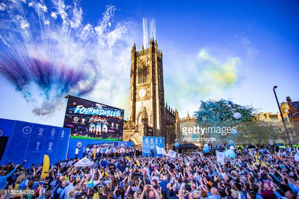 General view as players celebrate on the stage and fans show their support during the Manchester City Teams Celebration Parade on May 20 2019 in...