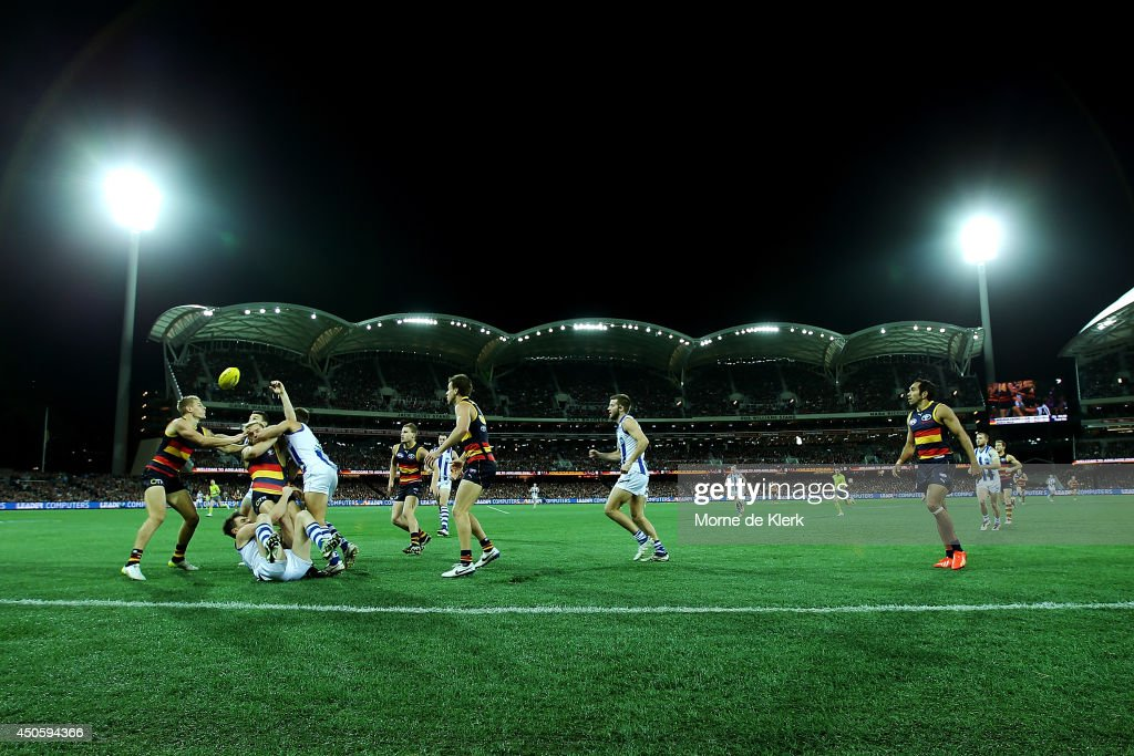 A general view as players from both sides compete for the ball during the round 13 AFL match between the Adelaide Crows and the North Melbourne Kangaroos at Adelaide Oval on June 14, 2014 in Adelaide, Australia.