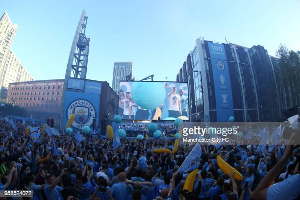 A general view as players of Manchester City acknowledges the fans from the stage during the Manchester City Trophy Parade on May 14 2018 in...