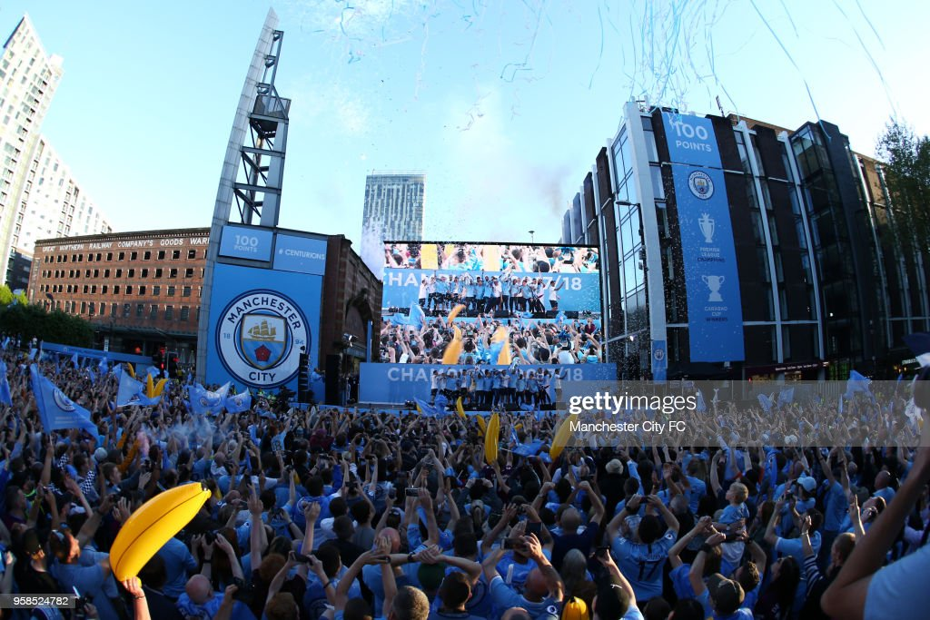 A general view as players of Manchester City celebrates on stage during the Manchester City Trophy Parade on May 14, 2018 in Manchester, England.