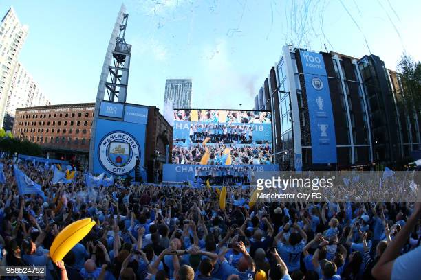 A general view as players of Manchester City celebrates on stage during the Manchester City Trophy Parade on May 14 2018 in Manchester England