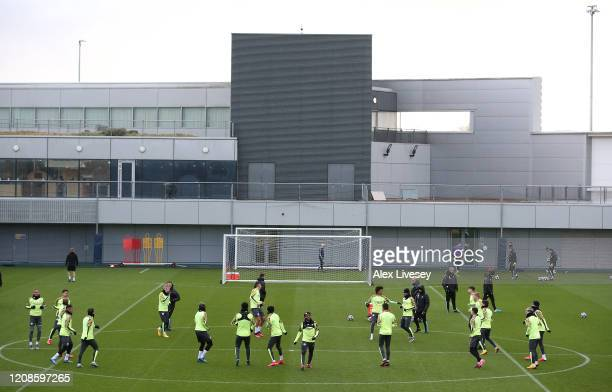 General view as players of Manchester City participate in a training session ahead of their UEFA Champions League round of 16 first leg match against...