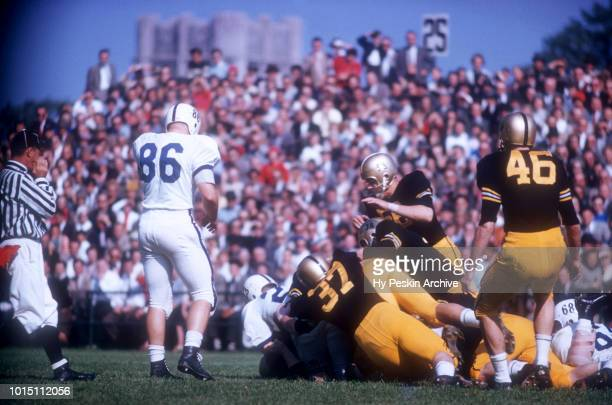 General view as players pile up during an NCAA game between the Army Cadets and the Penn State Nittany Lions on October 4 1958 at Michie Stadium in...