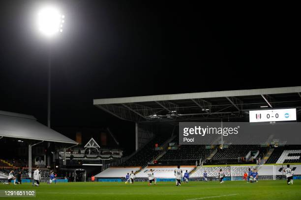 General view as players take a knee in support of the Black Lives Matter movement prior to the Premier League match between Fulham and Brighton &...