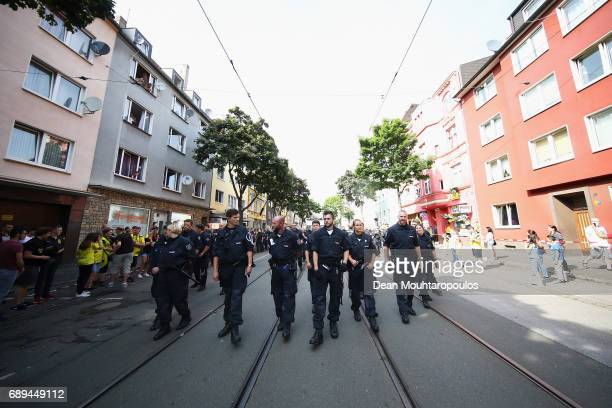 A general view as police and security lead the team bus during a parade near Borsigplatz for the celebrations of Borussia Dortmund's DFB Cup win on...