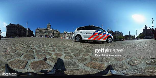 A general view as Police guard the tourists and the Royal Palace on May 11 2016 in Amsterdam Netherlands The Royal Palace or Koninklijk Paleis...