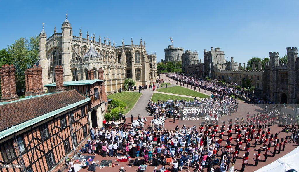 A general view as Prince Harry, Duke of Sussex and Meghan, Duchess of Sussex ride by carriage following their wedding at St George's Chapel, Windsor Castle on May 19, 2018 in Windsor, England. Prince Henry Charles Albert David of Wales marries Ms. Meghan Markle in a service at St George's Chapel inside the grounds of Windsor Castle. Among the guests were 2200 members of the public, the royal family and Ms. Markle's Mother Doria Ragland.