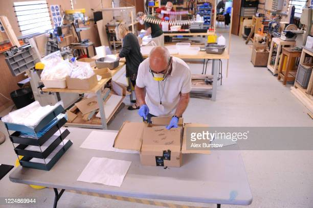 A general view as 'Project Shield' volunteer Martin packages fullface visors for distribution at the Church Crookham and Fleet Men's Shed on May 06...