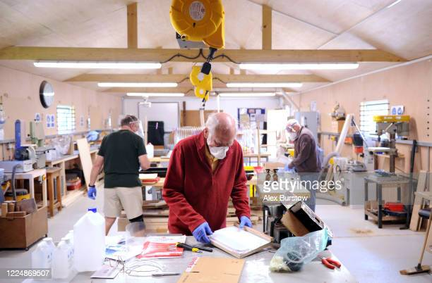 A general view as 'Project Shield' volunteer Trevor helps to produce fullface visors in the Church Crookham and Fleet Men's Shed on May 06 2020 in...