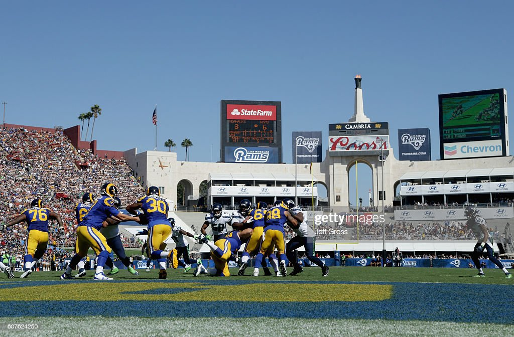 A general view as quarterback Case Keenum #17 of the Los Angeles Rams hands off to Todd Gurley #30 during the fourth quarter of the home opening NFL game against the Seattle Seahawks at Los Angeles Coliseum on September 18, 2016 in Los Angeles, California.