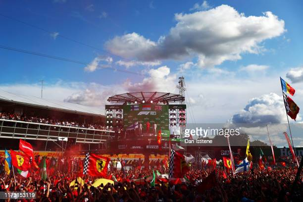 General view as race winner Charles Leclerc of Monaco and Ferrari celebrates on the podium with second placed Valtteri Bottas of Finland and Mercedes...