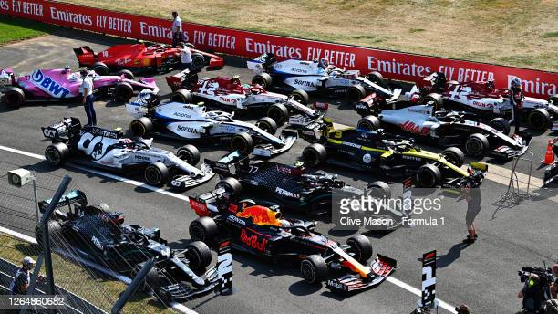 General view as race winner Max Verstappen of Netherlands and Red Bull Racing, second placed Lewis Hamilton of Great Britain and Mercedes GP and...