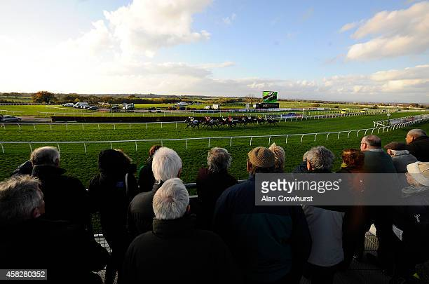 A general view as racegoers look on as the runners pass at Carlisle racecourse on November 02 2014 in Carlisle England