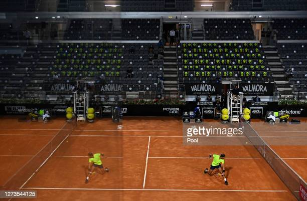 A general view as Rafael Nadal of Spain stretches to play a backhand in his quarterfinal match against Diego Schwartzman of Argentina during day six...