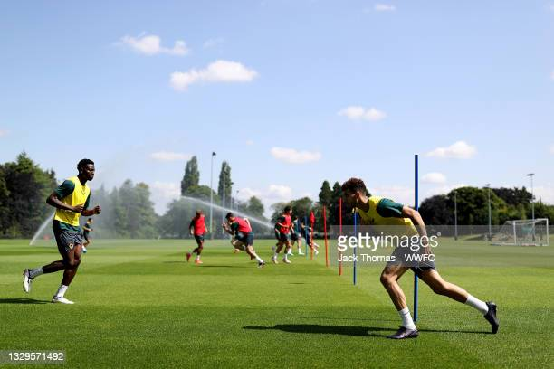 General view as Rayan Ait-Nouri and Owen Otasowie of Wolverhampton Wanderers run during a Wolverhampton Wanderers Pre-Season Training Session at Sir...