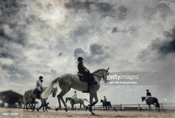 A general view as riders and horses warm up in the paddock during day 2 of the Longines Global Champions Tour of Antwerp at the Waagnatie on April 25...