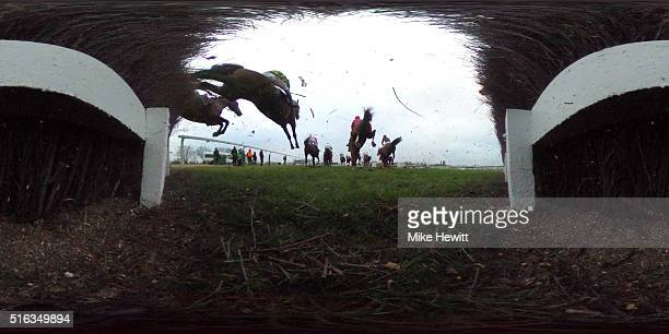 General view as riders jump during the Johnny Henderson Grand Annual Chase Challenge Cup as part of the Cheltenham Festival at Cheltenham Racecourse...