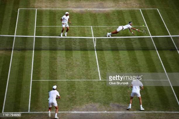 General view as Robert Farah of Colombia, playing partner of Juan Sebastian Cabal of Colombia dives to play a backhand in their Men's Doubles final...